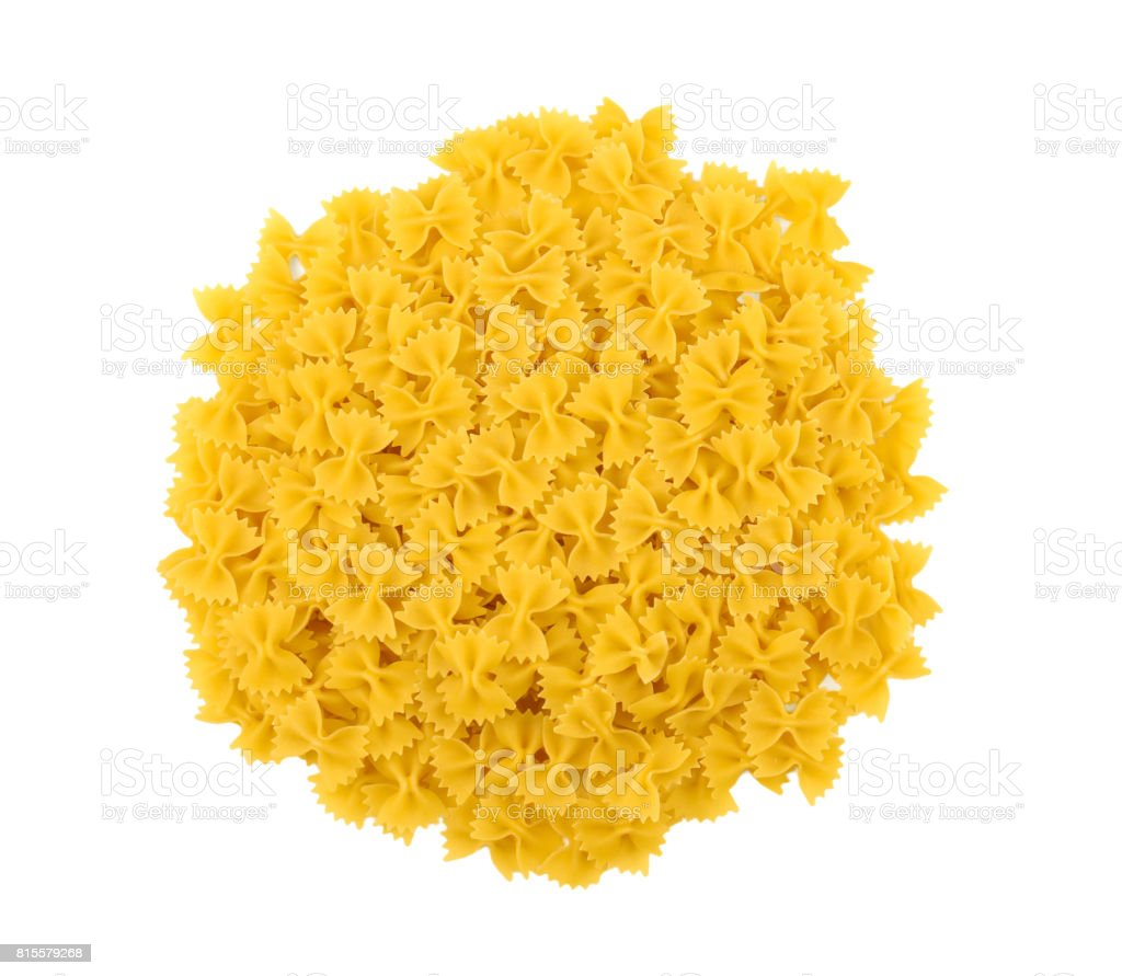 Uncooked yellow farfalle on a white isolated background. Typical Italian food pasta. Vegetarian dinner. Dry tasty macaroni. stock photo