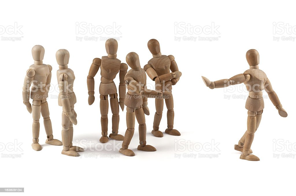 uncooperative wooden mannequin  in team discussion royalty-free stock photo