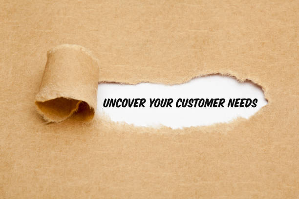 Uncover Your Customer Needs Business Concept Text Uncover Your Customer Needs appearing behind torn paper. Concept about the importance to understand the demands, requirements and expectations of your clients. dependency stock pictures, royalty-free photos & images