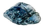 Uncut blue sapphire against white background