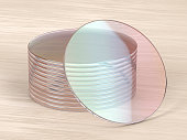 Round eyeglasses lens on wood background
