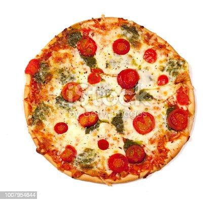 Uncut italian pizza mozzarella - tomato - pesto sauce, on white background. high angle view