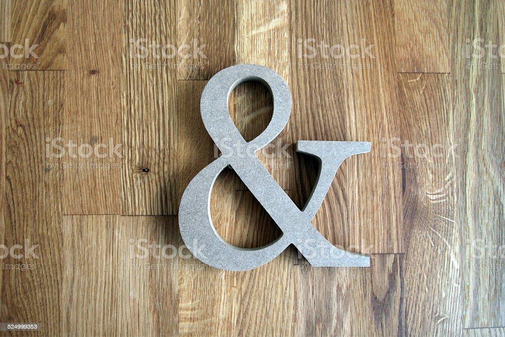 Und Zeichen auf Holz stock photo