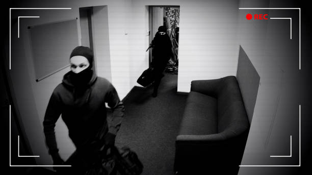 Undefined thieves escaping from place of crime, armed robbery, CCTV effect stock photo