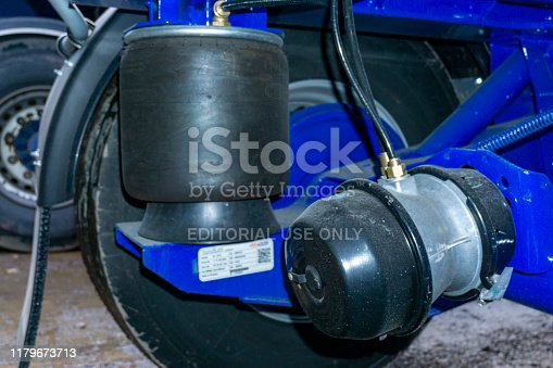 istock Under a Semi Trailer View of Brake Cylinder Pod and Inflated Air Suspension Bag 1179673713