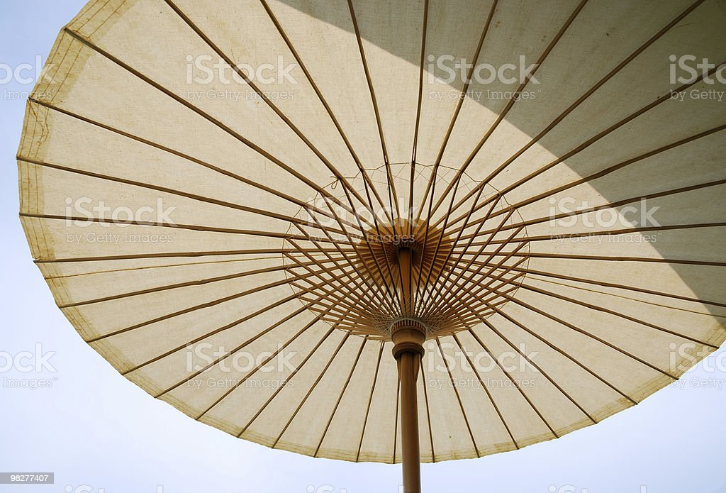 under a thai style beach umbrella royalty-free stock photo