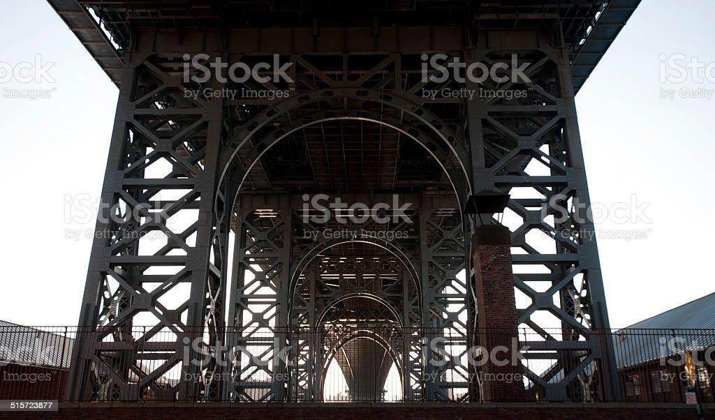 Under bridge tight shot showing constructed pillars daytime stock photo