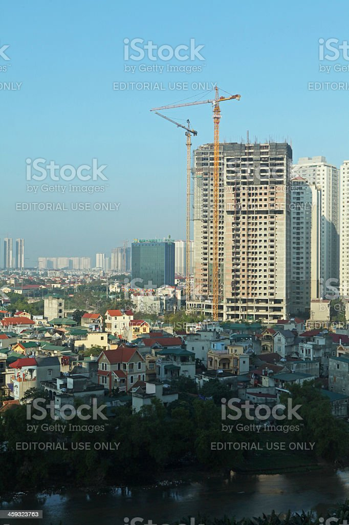 Under construction building next to apartment comlex stock photo