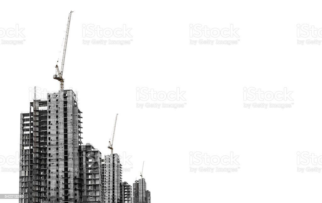 Under construction buildings with tower crane with copy space, isolated stock photo