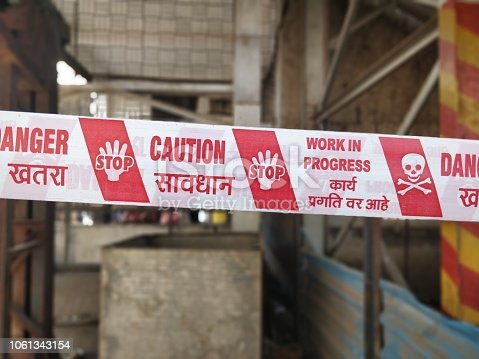 istock Under construction caution tapes 1061343154