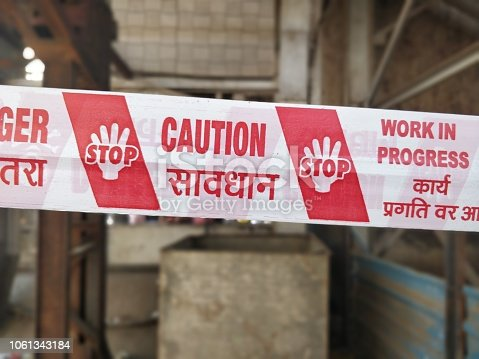 istock Under construction caution tapes 1061343184