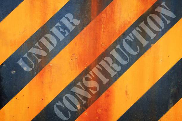Under construction concept, Warning hazard grunge rusty dirty pattern in yellow and black color stock photo