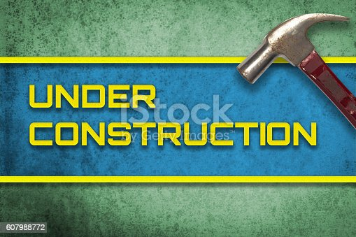 istock Under Construction green yellow banner with hammer 607988772