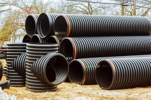 Under construction of housing of stacked PVC pipes on building