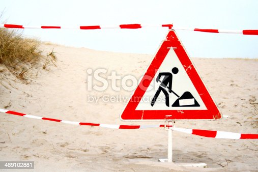 istock Under construction road sign at beach 469102881