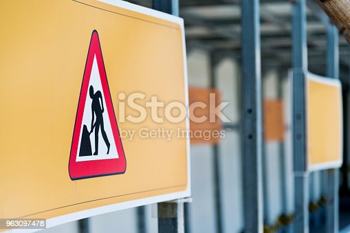 97709303 istock photo Under construction road sign 963097478