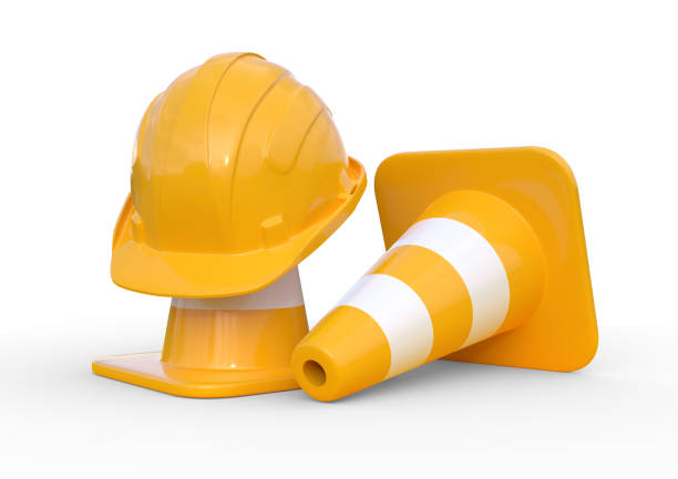 under construction, traffic cones and safety helmet, isolated on white background - under construction icon foto e immagini stock