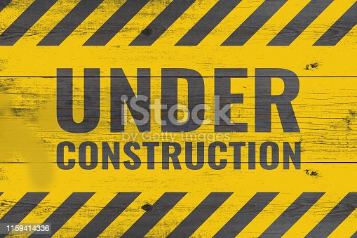 istock under construction warning message painted on aged wooden planks 1159414336