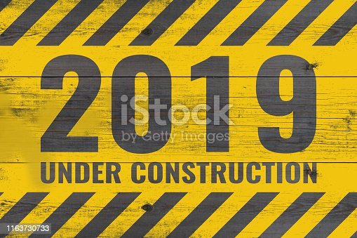 istock 2019 under construction warning message painted on aged wooden planks 1163730733