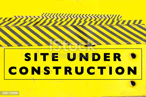istock Under construction web page or website banner 636739990
