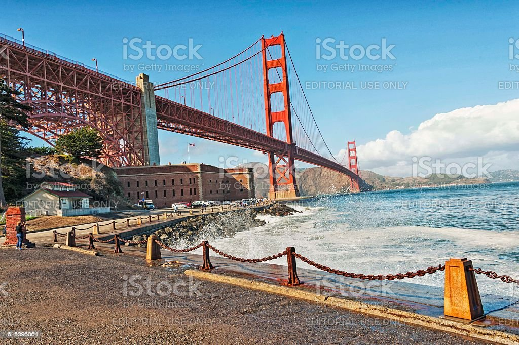 Under Golden Gate Bridged with Ft Point and Visitors stock photo