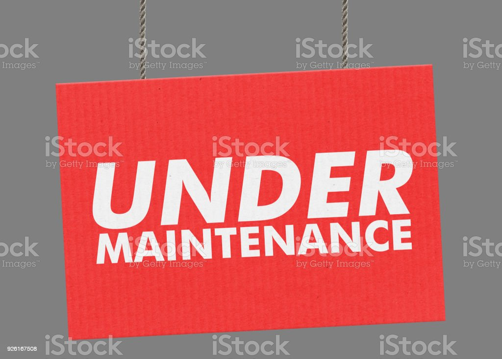 Under maintenance sign hanging from ropes. Clipping path included so you can put your own background. stock photo