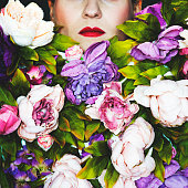 Studio portrait of a woman covering her face with many flowers.