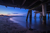 Wooden pier construction. Sea sunset