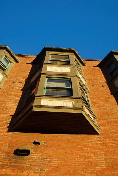 under red brick building stock photo