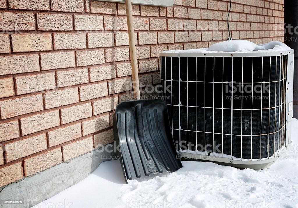 AC under snow stock photo