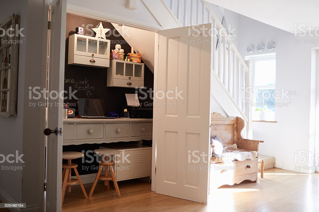 Under Stairs Home Office In Contemporary Family Home stock photo