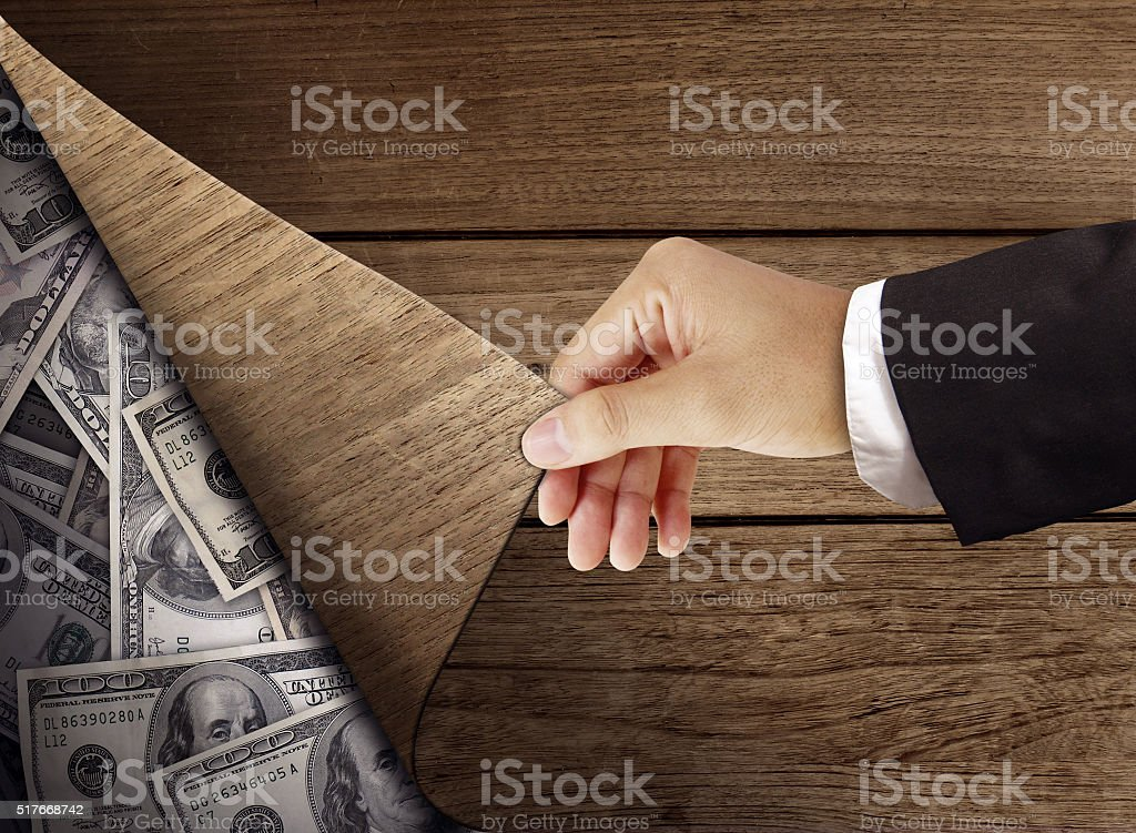 under table money stock photo