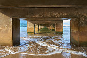...down by the sea. An interesting perspective from beneath a pier looking out at the ocean. Very strong perspective.