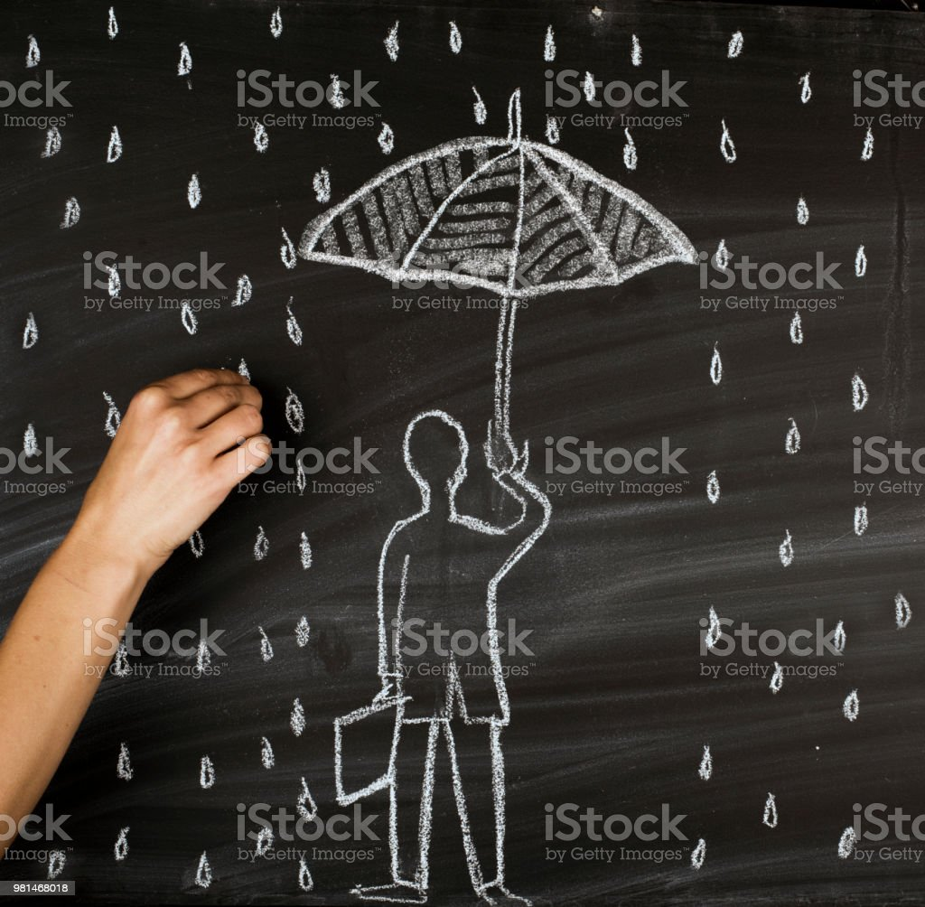 Under the falling rain,insurance concept stock photo