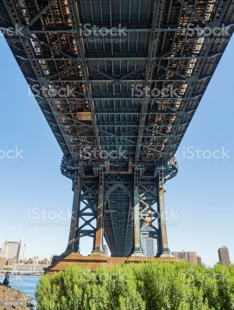 Under the Manhattan Bridge early in the morning with blue sky and sun shine stock photo