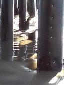 santa barbara, ca sterns wharf under pier sunlight usa reflections
