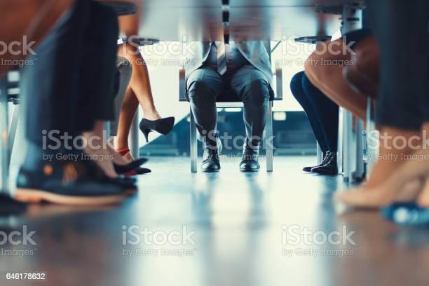 Under the table shot at business meeting picture id646178632?b=1&k=6&m=646178632&s=612x612&h=rdi yfjcv04cocwqvqoeqzlygdynuvk9kvy5no1vm g=