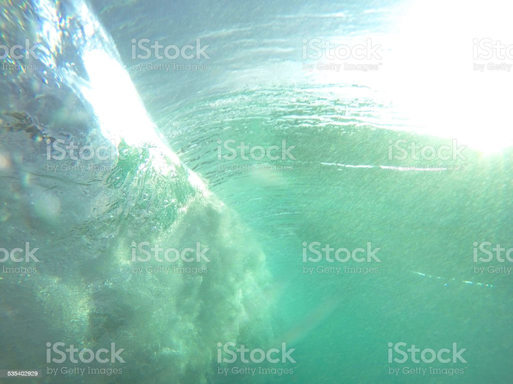 Under the wave stock photo