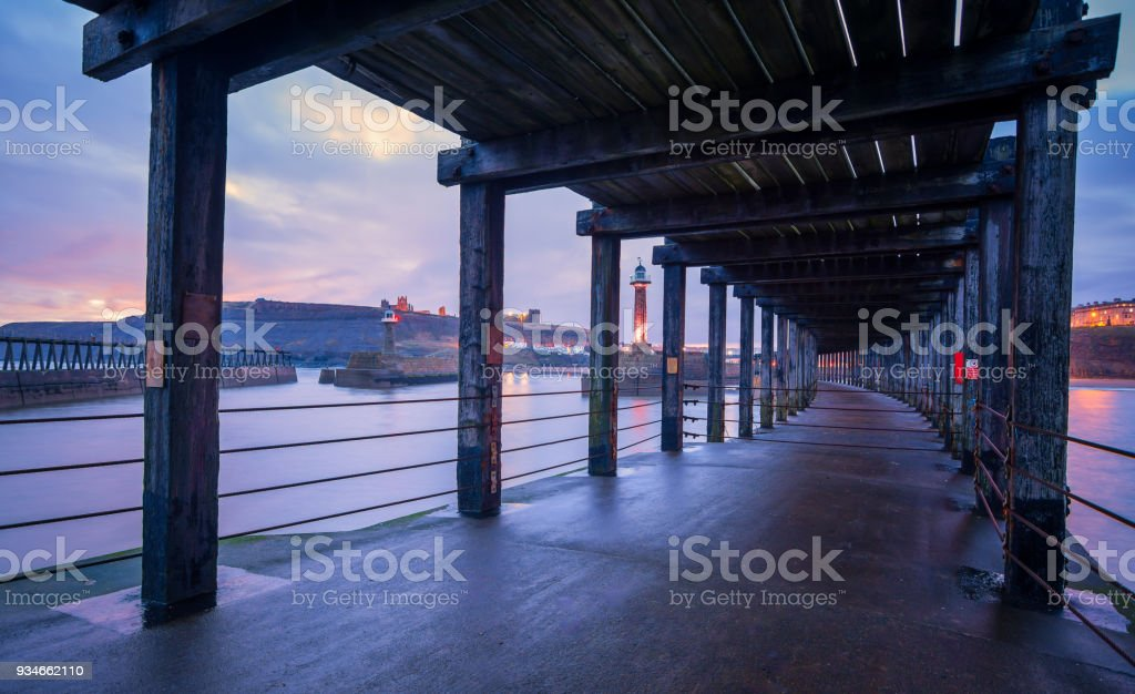 Under the wooden planks of Whitby West Pier stock photo