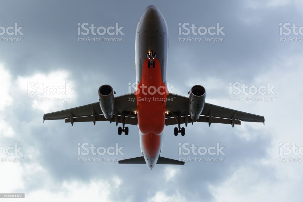 Under view of Airplane in the cloudy sky for background stock photo