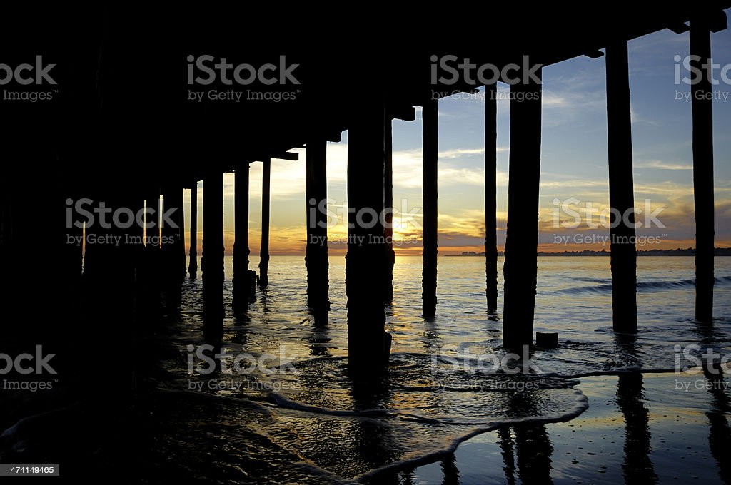 Under Wharf and Ocean at Sunset royalty-free stock photo