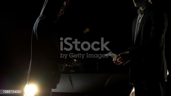 istock Undercover cop buying heroin from dealer on street, illegal drug trade, ambush 1093734052