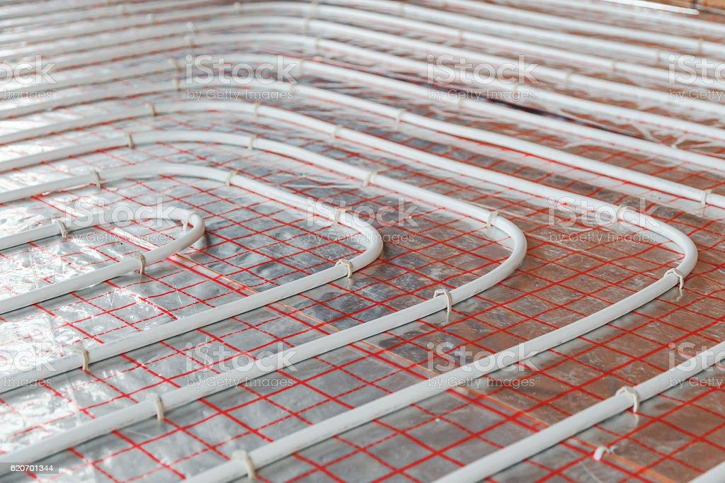 Underfloor heating installation. Close up on water floor  system interior stock photo