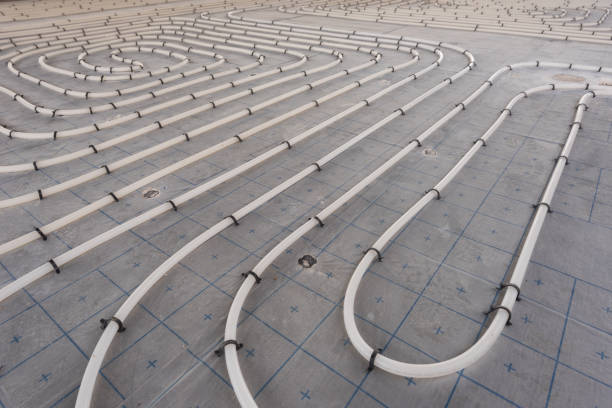 Underfloor heating system installation. Close up on water floor heating system interior of a new indoor swimming pool and SPA center. Plumbing pipes. Individual Heating. stock photo