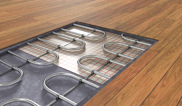 Underfloor heating system under wooden floor. 3D rendered illustration. stock photo