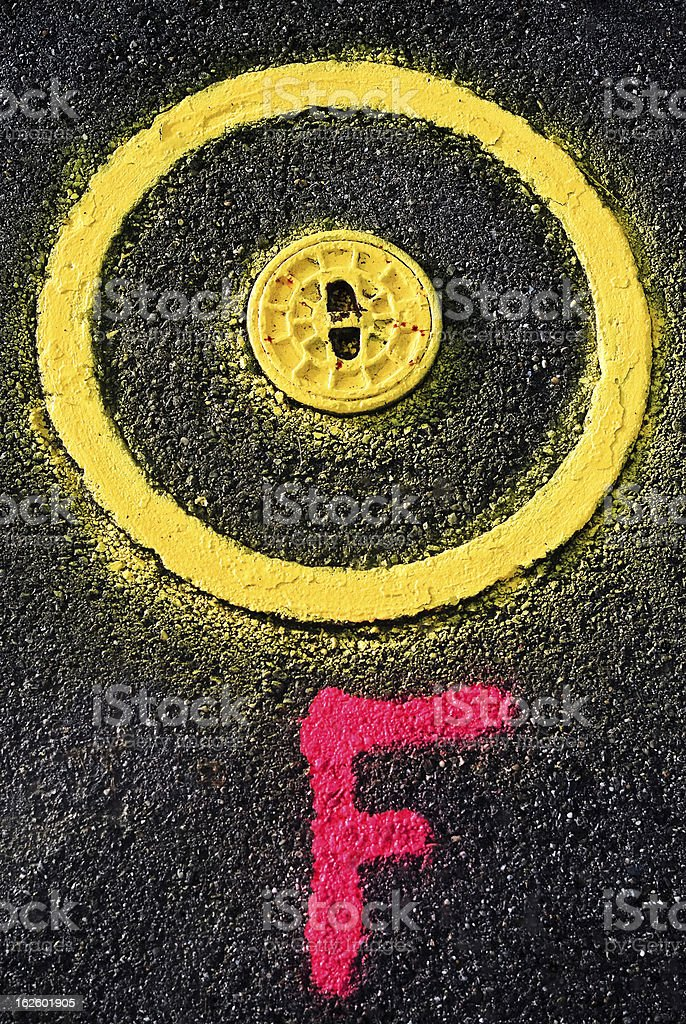 Underfloor hydrant with yellow paint and marker. royalty-free stock photo