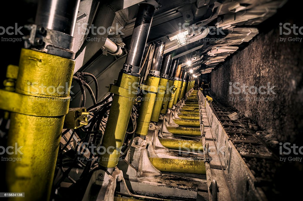 Underground corridor with steel support system in a coal mine stock photo