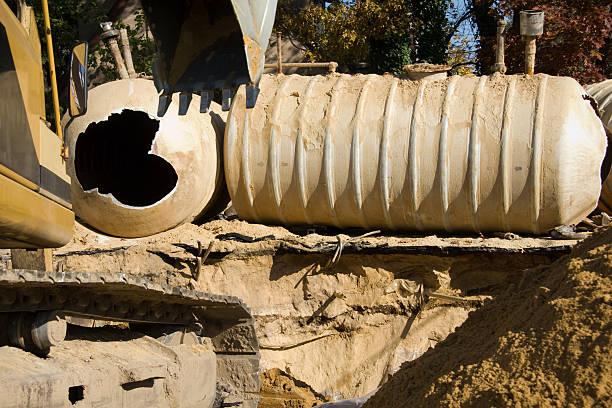 underground gas station storage tank replacement - brandstoftank stockfoto's en -beelden