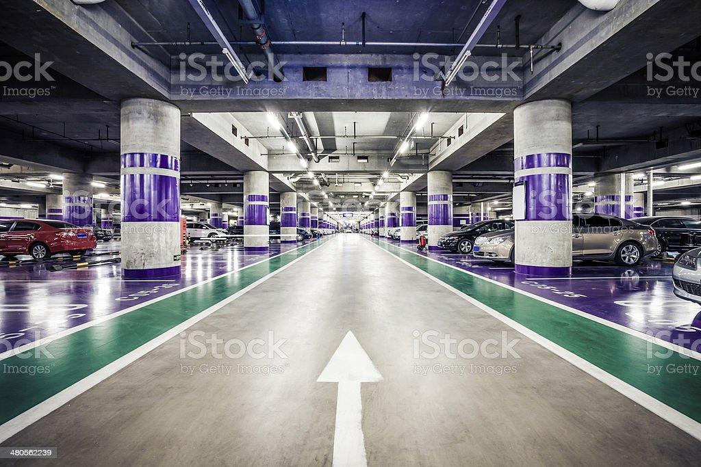 Underground parking aisle stock photo