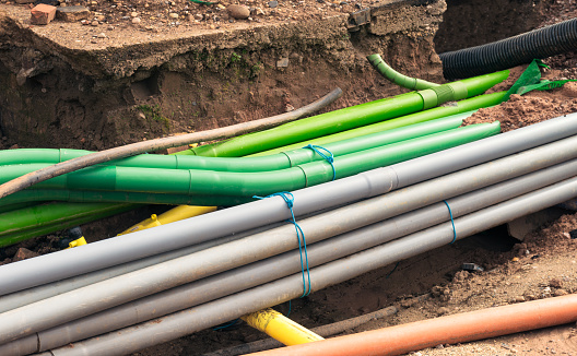 Engineering work: the installation of a large number of plastic pipes under the street.